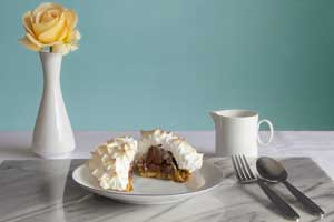 Baked Alaska with Mango & Passion Fruit Caramel Sauce